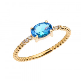 0.6ct Blue Topaz and Diamond Beaded Band Engagement Ring in 9ct Gold