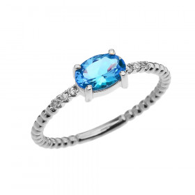 0.6ct Blue Topaz and Diamond Beaded Band Engagement Ring in 9ct White Gold