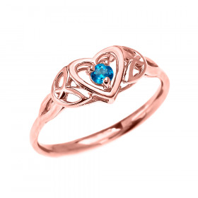 0.08ct Blue Topaz Trinity Knot Heart Engagement Ring in 9ct Rose Gold