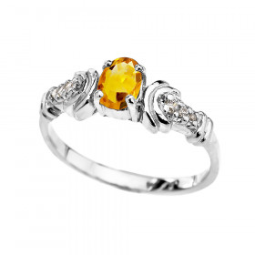 0.25ct Citrine and Diamond Oval Engagement Ring in 9ct White Gold